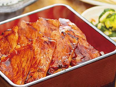 こだわりの十勝豚と帯広の本店より受け継いだタレ、北海道特産のAブランド米による絶妙な味わいの豚丼